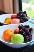 Variety of fresh fruits in whie bowl Stock Photos
