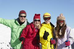 Stock Photo of Teenage Family On Ski Holiday In Mountains