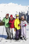Teenage Family On Ski Holiday In Mountains - stock photo