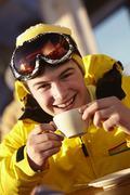 Teenage Boy Enjoying Hot Drink In Caf̩ At Ski Resort Stock Photos