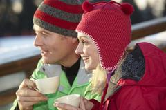 Couple Enjoying Hot Drink In Caf̩ At Ski Resort - stock photo