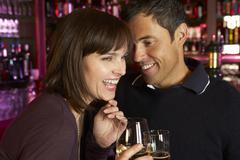 Couple Enjoying Drink Together In Bar Stock Photos