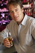 Man Enjoying Drink At Bar Stock Photos