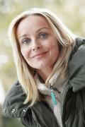 Outdoor Portrait Of Woman Wearing Winter Clothes Stock Photos
