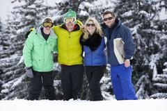 Group Of Young Friends On Ski Holiday In Mountains - stock photo