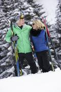 Young Couple On Ski Holiday In Mountains - stock photo