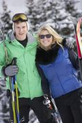 Stock Photo of Young Couple On Ski Holiday In Mountains