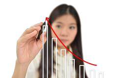 Business woman drawing a graph Stock Photos