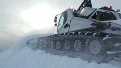 Snowcat runs on the mountain peak 3 Stock Footage