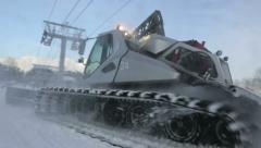 Snowcat runs on the mountain peak 6 Stock Footage