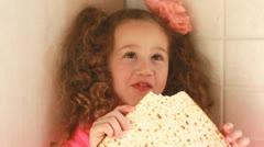 Girl eating matza Stock Footage