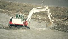 Tractor ladle digging a hole in the river - stock footage
