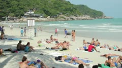 Young people on the beach - stock footage