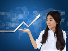 business woman and a graph - stock photo