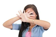 Confident woman making stop gesture sing with hand Stock Photos