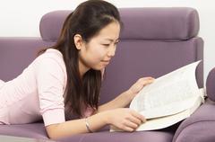 Woman reading a book Stock Photos