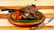Stock Video Footage of ready to eat grilled ribs on wooden plate