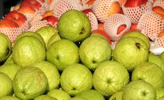 fresh guavas and apples for sale - stock photo