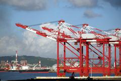 Stock Photo of container cranes and industrial ships