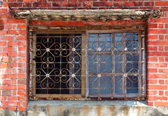 old windw with iron bars - stock photo
