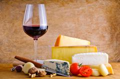Rustic snack with cheese and wine Stock Photos