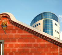 chinese farmhouse and modern facade - stock photo