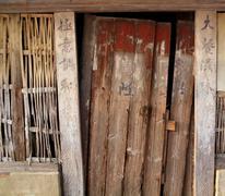 old broken chinese door - stock photo