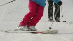 Girls ski the mountain Stock Footage