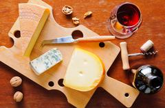 Cheese plate and red wine Stock Photos