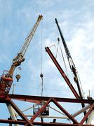 two cranes at construction site - stock photo