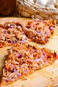 Pizza with tuna and onions Stock Photos