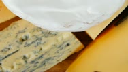 Different cheeses served on wooding cutting board Stock Footage
