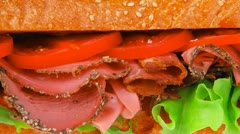 French sandwich : fresh white baguette with chicken smoked sausage Stock Footage