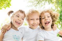 Low angle view portrait of happy children Stock Photos