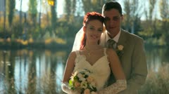 Bride and Groom Kissing Stock Footage