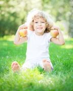 child with apples - stock photo