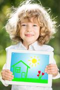 Child holding tablet pc Stock Photos