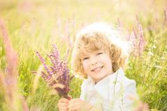 Child holding flowers Stock Photos