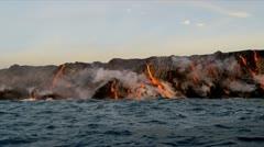 Molten Lava Pouring into Ocean Kilauea Hawaii - stock footage