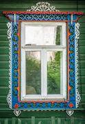 window of old traditional russian wooden house. - stock photo