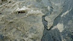 Dirty snow and water on the asphalt Stock Footage