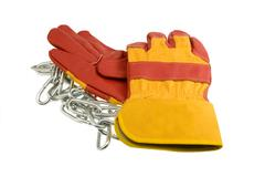 Red protective gloves with steel chain Stock Photos