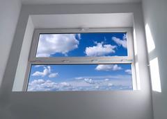 Window with blue sky Stock Photos
