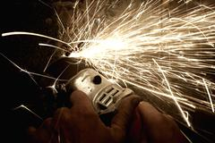 Sparks from a worker grinding steel Stock Photos