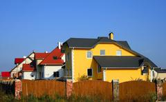 Street with several houses at neighborhood. Stock Photos