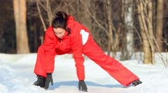 Girl does body exercises, winter afternoon on snow Stock Footage