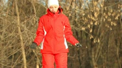 Girl does body exercises, jumps, winter afternoon on snow Stock Footage