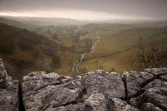 Stock Photo of limestone pavement overlooking malham beck and dale in yorkshire dales nation