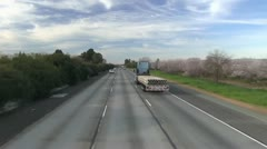 Freeway driving, California, almond orchard Stock Footage