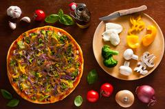 Vegetarian pizza and ingredients Stock Photos